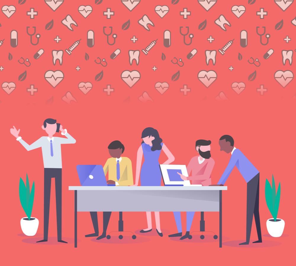 grupo de pessoas ao redor de uma mesa de trabalho, ao fundo aparecem símbolos referentes à saúde para dar ideia de plano de saúde na empresa